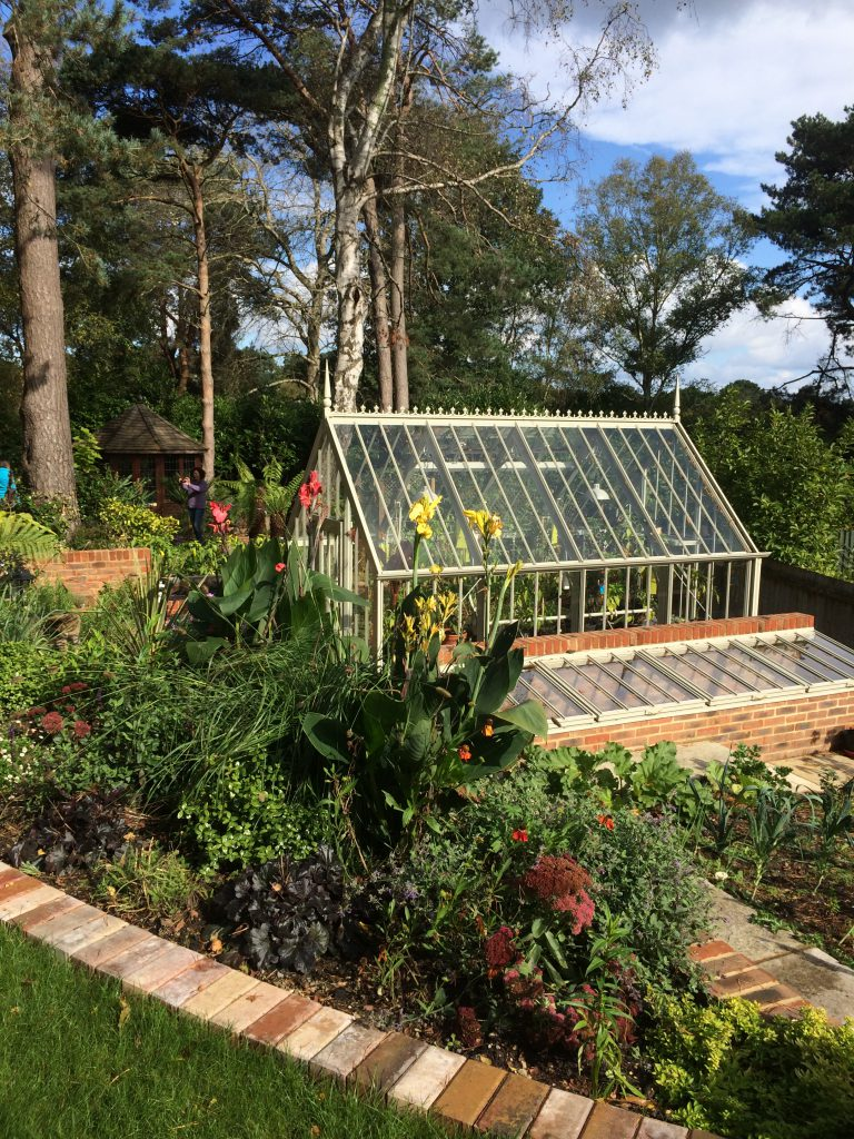 A Sloping Site Is Terraced To Allow A Greenhouse And Workable Vegetable  Beds To Be Created